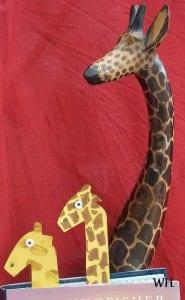 Herd of wooden and card giraffes